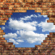 Stock Photo: Brick wall with sky