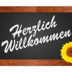 Herzlich Willkommen, welcome sign — Stock Photo