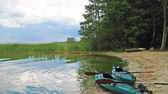 Canoes at riverside — Stock Photo