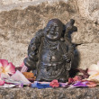 Statue representing chinese laughting Buddha - Stock Photo