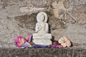 Marble stone carving Buddha from India with orchid flowers — Stock Photo