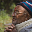 Old man, nepali face, tharu culture, west Nepal — Stock Photo #27036301