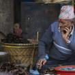 Old nepali man selling in Kathmandu market — Stock Photo