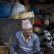 Old nepali man selling in Kathmandu market — Photo