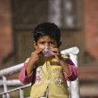 Unidentified nepali boy drinking tea — Stock Photo