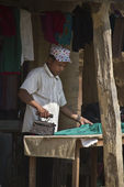 Taru man doing the ironing with old iron — Foto Stock