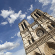 Stock Photo: Notre Dame Cathedral in Paris with dramatic blue sky