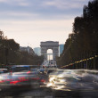Stock Photo: Triumphal Arch and Champ Elysses in Paris with moving cars