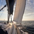 Sailing on yacht in to the sun — Stockfoto