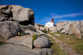 Lighthouse among the boulders on Lavezzi island, Corsica, France — Stock Photo