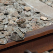 A stack of granite rocks on old railway tracks — Stock Photo