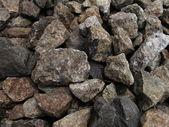 Piedras a lo largo de un rack de ferrocarril — Foto de Stock