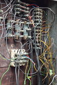 Closeup of old electric box with wiring — Stock Photo