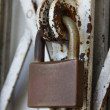 Padlock on old gate — Stock Photo