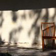 Abandoned chair in shadows — Stock Photo
