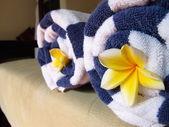 Beach towel with flowers — Stock Photo