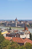 A view of the Parliament from the Fishermens Bastion located in the Buda part of the city of Budapest — Stock Photo