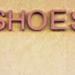 Stock Photo: Shoes sign on wall