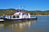 View of a small local ferry boat on a Visigrad side of the Danube river, Hungary — Stock Photo