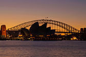 Sydney Harbour Bridge and Sydney Opera House at sunset — Stock Photo