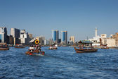 Skyline view of Dubai Creek with traditional boat taxi, UAE — Stock Photo