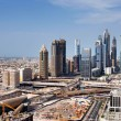 Stock Photo: Skyline view of Dubai showing how tall buildings dwarf villas