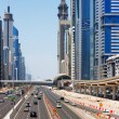 Sheikh Zayed Road is graced with skyscrapers and intense traffic — Stock Photo #15755333