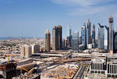 A skyline view of Dubai showing how the tall buildings dwarf the villas — Stock Photo