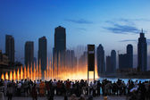 One of UAE's most famous attraction is the Dubai Fountain, crowds gather every hour to watch the water dance — Stock Photo