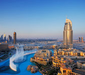 Downtown Dubai is becoming even more popular for tourism largely because of the dancing water fountain — Stock Photo