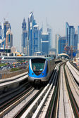 The Dubai Metro is becoming increasingly popular among expatriates traveling to and from work — Stock Photo