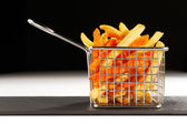 A beautiful basket of fried chips also known as French Fries — Foto Stock