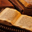 An ancient hand scripted Quran - Stock Photo