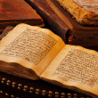 An ancient hand scripted Quran — Stock Photo