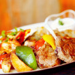 A mixed grill with lamb chops, chicken and capsicum and wedges — Stock Photo