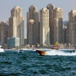 Yacht racing and power boating in Dubai Marina - Stock Photo