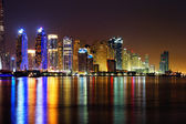 Dubai Marina, UAE at dusk as seen from Palm Jumeirah — Stock Photo