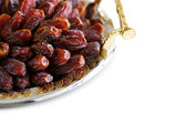 Dried Arabic dates presented on an ornate tra — Stock Photo