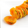 Dried Apricots stuffed sliced pistachios are a popular delicacy — Stock Photo