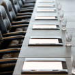 Stock Photo: Boardroom table is set for meeting