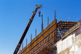 Mobile crane is poised to lift reinforced concrete shuttering — Stock Photo
