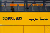 A close-up view of a yellow Arabic school bus — Stock Photo