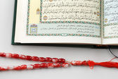 "The Quran literally meaning ""the recitation"", is the central religious text of Islam — Stockfoto"
