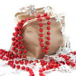 Bag with beads and snowflakes — Stock Photo
