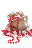 Red beads and snowflakes in a bag — Stock Photo