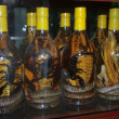 Постер, плакат: Bottles with snakes and scorpions in street shop
