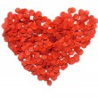 Red heart of confetti on white background — Stock Photo