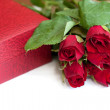 Packing box and red roses — Stock Photo