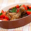 Baked chicken legs with tomato and herbs — Stock Photo