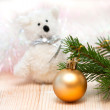 Toy polar bear and an orange ball on the Christmas tree — Stock Photo